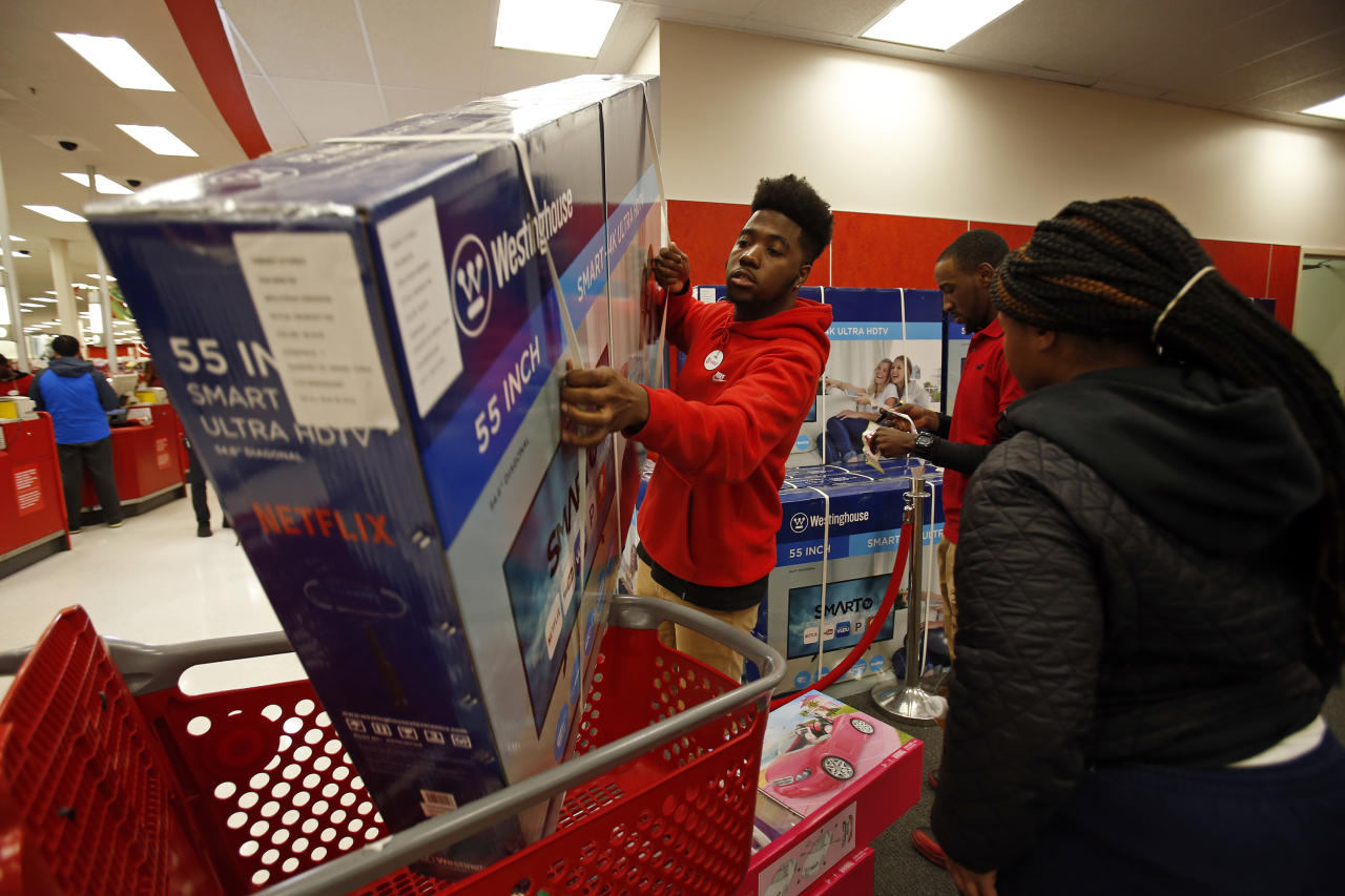 IMAGE DISTRIBUTED FOR TARGET - A Target team member assists a customer with a TV purchase on Thursday, Nov. 23, 2017, in Jersey City, N.J. (Adam Hunger/AP Images for Target)