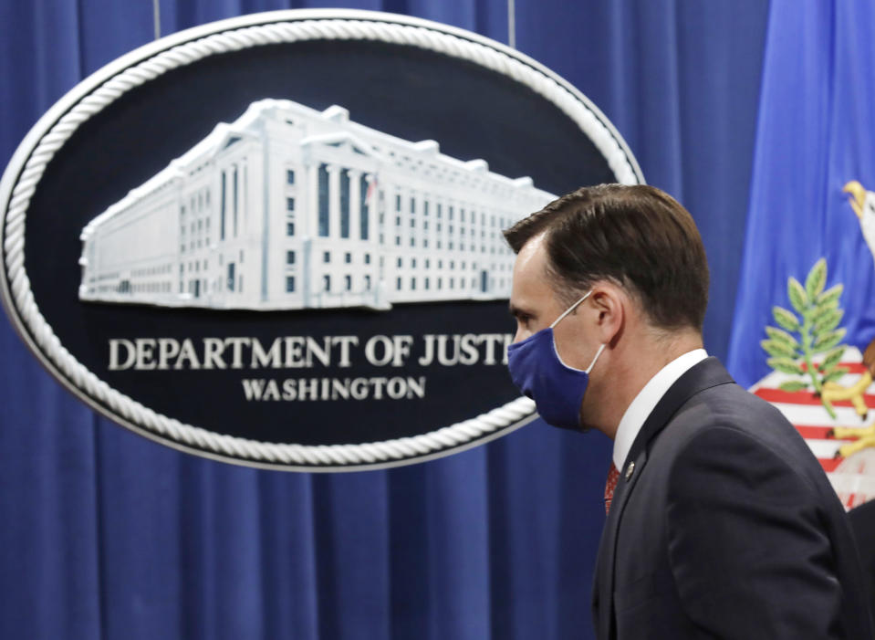 Acting Assistant Attorney General Brian Rabbitt, of the Justice Department's Criminal Division, walks off after speaking at the Justice Department, Thursday, Oct. 22, 2020, in Washington. A subsidiary of Goldman Sachs pleaded guilty on Thursday and agreed to pay more than $2 billion in a foreign corruption probe tied to the Malaysian 1MDB sovereign wealth fund, which was looted of billions of dollars in a corruption scandal. The company, Goldman Sachs Malaysia, entered the plea in federal court in Brooklyn. (Yuri Gripas/The New York Times via AP, Pool)