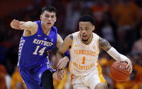 Tennessee guard Lamonte Turner (1) drives against Kentucky guard Tyler Herro (14) during the second half of an NCAA college basketball game Saturday, March 2, 2019, in Knoxville, Tenn. Tennessee won 71-52. (AP Photo/Wade Payne)