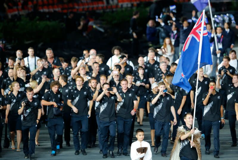 New Zealand's flag bearer Willis holds the national flag as he leads the contingent in the athletes parade during the opening ceremony of the London 2012 Olympic Games at the Olympic Stadium