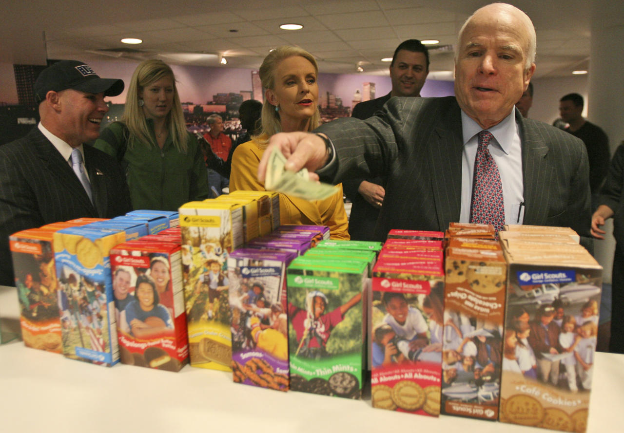 Republican presidential candidate, Sen. John McCain, R-Ariz., pays for girl scout cookies during a visit to USO lounge at the Baltimore Washington International Airport in Baltimore, Wednesday, April 2, 2008, during his Service to America tour.  (AP Photo/Mary Altaffer)