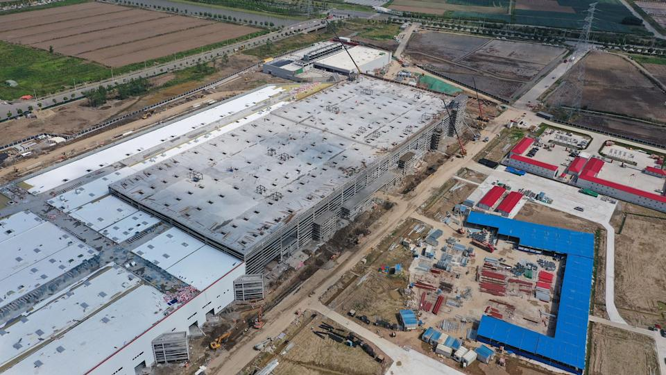 SHANGHAI, CHINA - JUNE 08: Aerial view of the construction site of Tesla Shanghai Gigafactory at the Lingang Area on June 8, 2019 in Shanghai, China. U.S. electric carmaker Tesla signed an agreement with the Shanghai municipal government in July 2018 to build the factory. Tesla Shanghai Gigafactory is designed with an annual capacity of 500,000 electric cars. (Photo by VCG/VCG via Getty Images)
