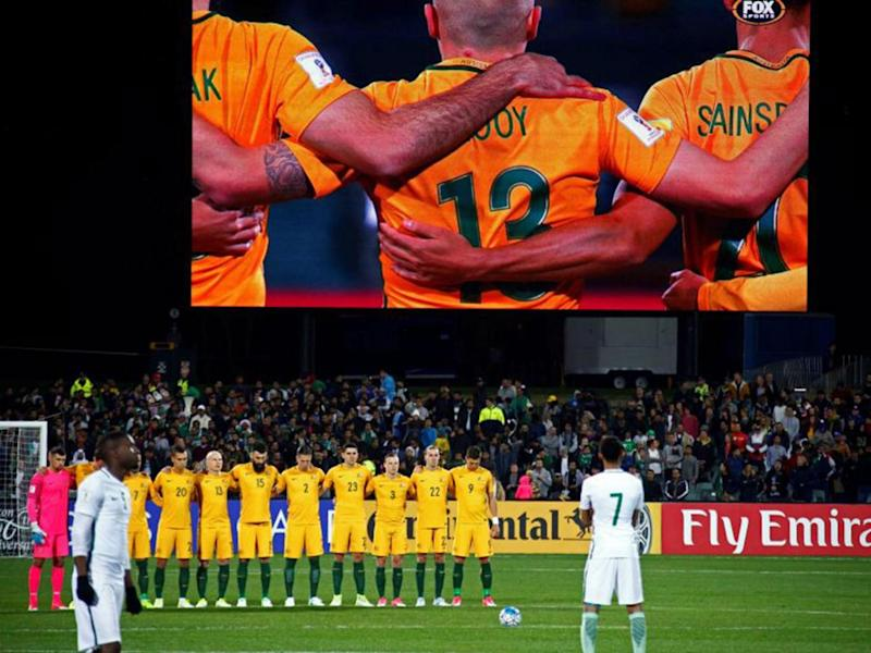 Television pictures show the Saudi players snubbing the minute's silence (Reuters)