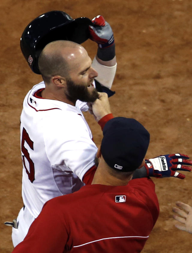 Boston Red Sox's Dustin Pedroia has his beard tugged by teammate David Ross as he arrives at the dugout after his solo home run against the Baltimore Orioles in the first inning of a baseball game at Fenway Park in Boston, Tuesday, Sept. 17, 2013. (AP Photo/Elise Amendola)
