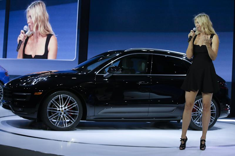 Tennis player Maria Sharapova talks about the new Porsche Macan Turbo at the Los Angeles Auto Show in Los Angeles, Tuesday, Nov. 19, 2013. (AP Photo/Chris Carlson)