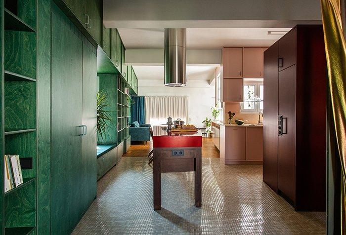 Colorful kitchen area inside Point Supreme's renovated Athens apartment.
