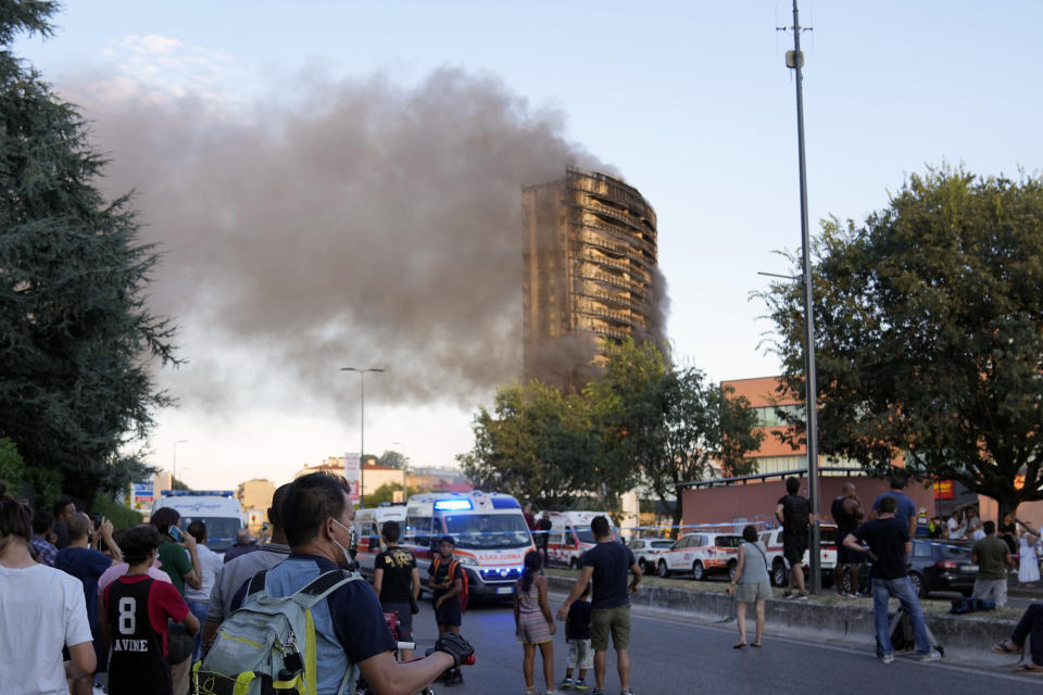 Smoke billows from a building in Milan, Italy, Sunday, Aug. 29, 2021. Firefighters were battling a blaze on Sunday that spread rapidly through a recently restructured 60-meter-high, 16-story residential building in Milan. There were no immediate reports of injuries or deaths. (AP Photo/Luca Bruno)