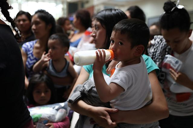 Undocumented immigrant families look on as they are released from detention at a bus depot in McAllen, Texas, on June 22. (Photo: Loren Elliott/Reuters)