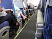 """Surely, this won't surprise you, but the floor of the airplane is teeming with <a href=""""https://bestlifeonline.com/most-common-classroom-germs/?utm_source=yahoo-news&utm_medium=feed&utm_campaign=yahoo-feed"""" rel=""""nofollow noopener"""" target=""""_blank"""" data-ylk=""""slk:germs"""" class=""""link rapid-noclick-resp"""">germs</a>. """"Just think of hundreds of pairs of feet walking up and down per flight—hundreds of flights per year,"""" says <strong>Anthony Bianco</strong>, a travel writer at <a href=""""https://www.thetraveltart.com/"""" rel=""""nofollow noopener"""" target=""""_blank"""" data-ylk=""""slk:The Travel Tart"""" class=""""link rapid-noclick-resp"""">The Travel Tart</a>. """"I also had one of my friends tell me about a flight he took overseas where the toilet failed, and the toilet water started gushing down the aisle. No further explanation needed!"""""""