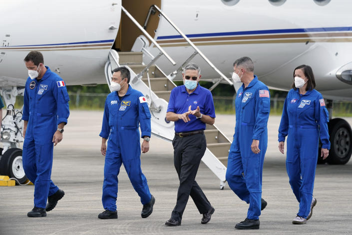 Kennedy Space Center director Bob Cabana, center, welcomes SpaceX Crew 2 astronauts, from left, European Space Agency astronaut Thomas Pesquet, Japan Aerospace Exploration Agency astronaut Akihiko Hoshide, and NASA astronauts Shane Kimbrough and Megan McArthur as they arrive at the Kennedy Space Center in Cape Canaveral, Fla., Friday, April 16, 2021. The launch to the International Space Station is targeted for April 22. (AP Photo/John Raoux)
