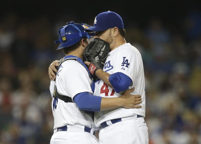 Los Angeles Dodgers starting pitcher Ricky Nolasco, right, talks to catcher Tim Federowicz during the fourth inning a baseball game against the Arizona Diamondbacks on Monday, Sept. 9, 2013, in Los Angeles. (AP Photo/Jae C. Hong)