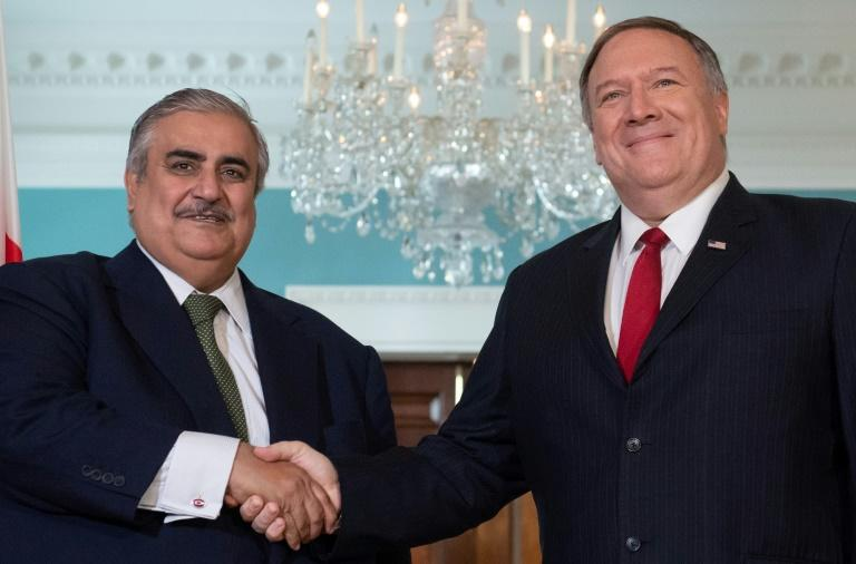 Bahraini Foreign Minister Sheikh Khalid bin Ahmed Al Khalifa (L) shakes hands with US Secretary of State Mike Pompeo prior to meetings at the State Department on July 17