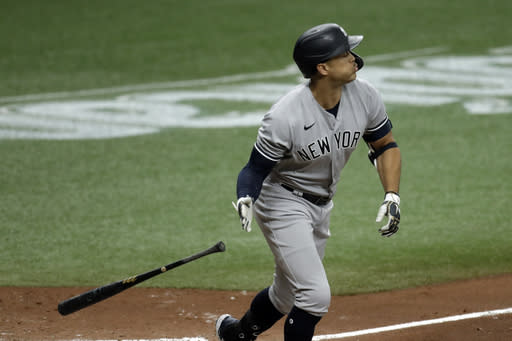 New York Yankees' Giancarlo Stanton drops his bat as he watches his solo home run off Tampa Bay Rays pitcher Sean Gilmartin during the fifth inning of the first game of a doubleheader baseball game Saturday, Aug. 8, 2020, in St. Petersburg, Fla. (AP Photo/Chris O'Meara)