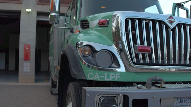 The U.S. Forest Service drives in green trucks to the scene of fires, not in the traditional red trucks usually associated with firefighters.