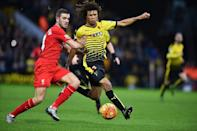 Watford's Nathan Ake in action against Liverpool's Jordan Henderson during the English Premier League match at Vicarage Road Stadium, on December 20, 2015 (AFP Photo/Ben Stansall)