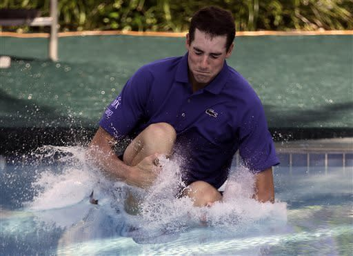 John Isner jumps into a swimming pool following his win over Nicolas Almagro, of Spain, in a singles final tennis match at the U.S. Men's Clay Court Championship, Sunday, April 14, 2013, in Houston. Isner won 6-3, 7-5. (AP Photo/Eric Gay)