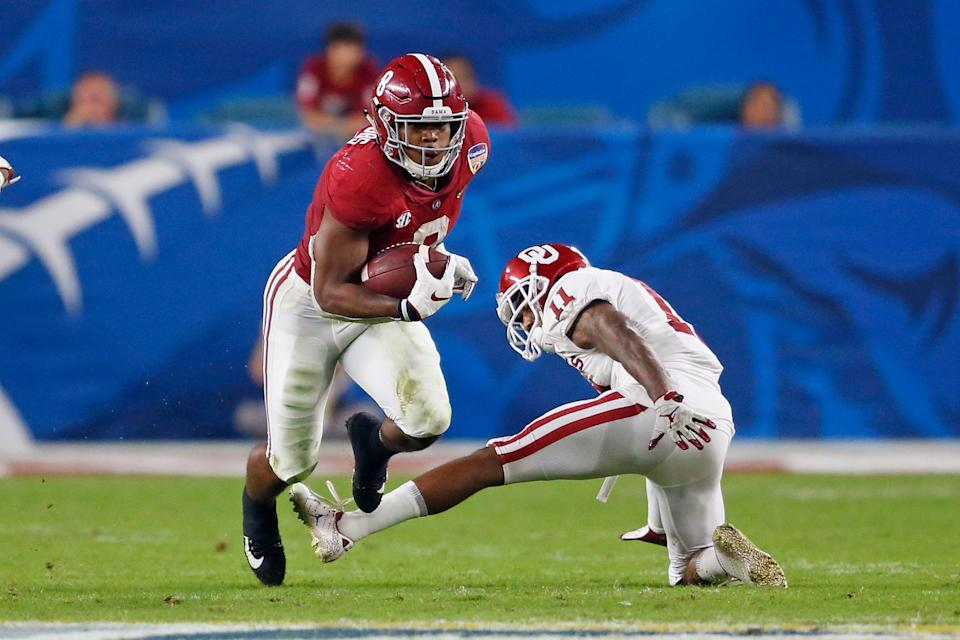 MIAMI GARDENS, FL - DECEMBER 29: Josh Jacobs #8 of the Alabama Crimson Tide runs past the attempted take by Parnell Motley #11 of the Oklahoma Sooners during the College Football Playoff Semifinal at the Capital One Orange Bowl at Hard Rock Stadium on December 29, 2018 in Miami Gardens, Florida. (Photo by Joel Auerbach/Getty Images)