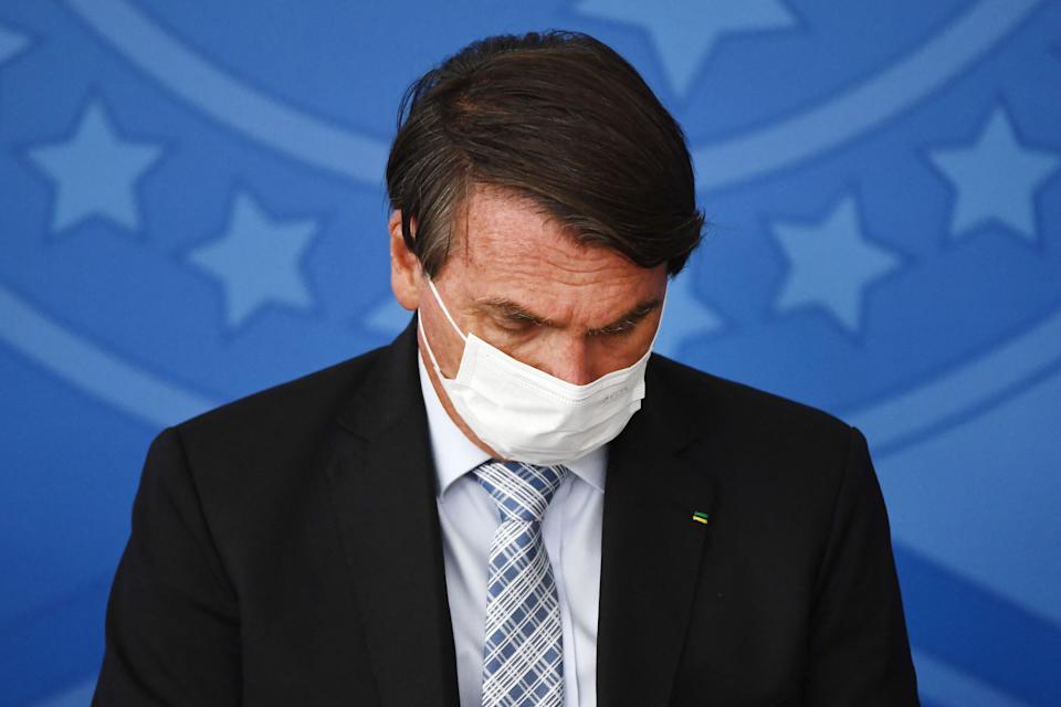 Brazilian President Jair Bolsonaro attends the sanction of the law that authorizes states, municipalities and the private sector to buy vaccines against COVID-19, at the Planalto Palace in Brasilia, on March 10, 2021. - Until now, with more than 260,000 deaths by the coronavirus, only the federal Government was authorized to buy vaccines. (Photo by EVARISTO SA / AFP) (Photo by EVARISTO SA/AFP via Getty Images)