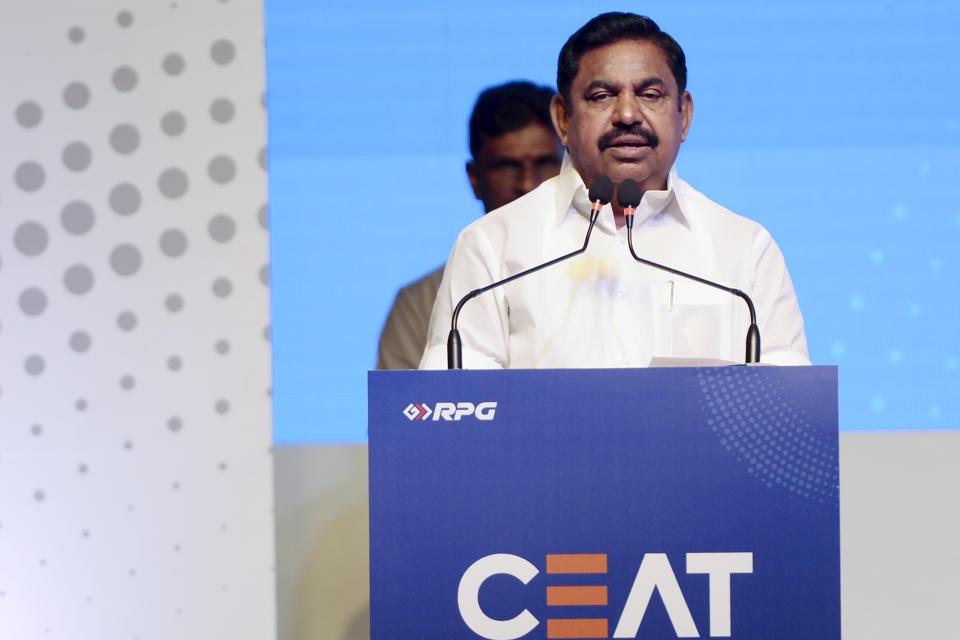 Managing Director of CEAT Tyres Anant Goenka (L) along with Chief Minister of Tamil Nadu Edappadi K. Palaniswami (2R) stand on stage during the inauguration of the CEAT Tyres plant in Chennai on February 12, 2020. (Photo by Arun SANKAR / AFP) (Photo by ARUN SANKAR/AFP via Getty Images)
