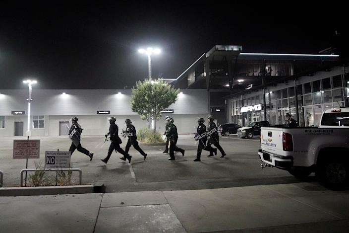 Police move into position during a protest on Election Day, Tuesday, Nov. 3, 2020, in Los Angeles.