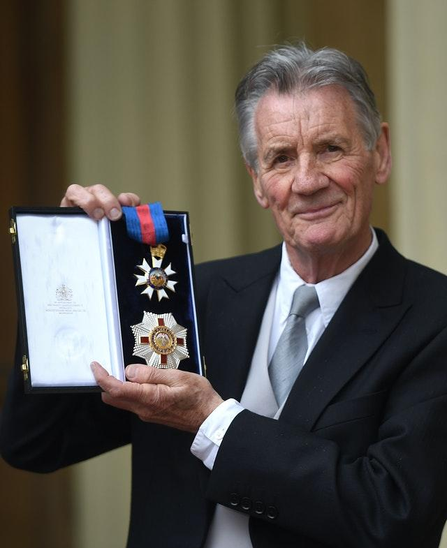 Sir Michael Palin was knighted at Buckingham Palace