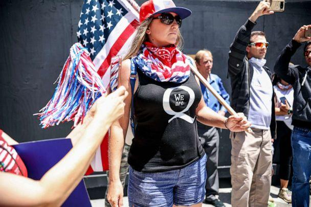 PHOTO: Conspiracy theorist QAnon demonstrators protest during a rally to re-open California and against Stay-At-Home directives on May 1, 2020 in San Diego, California. (Sandy Huffaker/AFP via Getty Images)