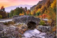 """<p>One of the most photographed bridges in the Lake District, Ashness Bridge is a real hidden gem. It's a traditional stone-built bridge on the single-track road from the Borrowdale road and makes an excellent autumn wander. </p><p><a class=""""link rapid-noclick-resp"""" href=""""https://www.cumbria.com/attractions/ashness-bridge"""" rel=""""nofollow noopener"""" target=""""_blank"""" data-ylk=""""slk:MORE INFO"""">MORE INFO</a></p>"""