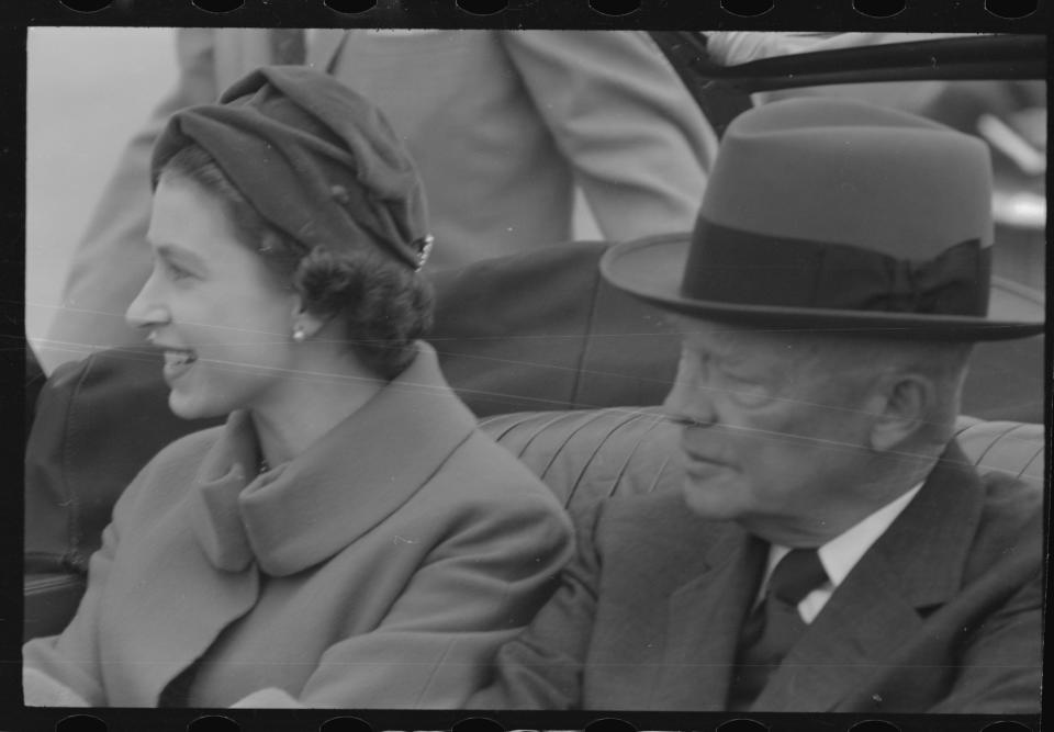 Britain's Queen Elizabeth sits in an open limousine beside President Dwight D.Eisenhower as they await the start of their motorcade into and through Washington, D.C. These were less perilous times when personal security for world leaders was less stringent