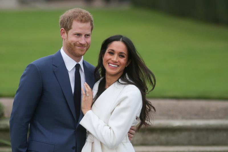 Prince Harry and Meghan Markle pose for a photo after announcing their engagement on Nov. 27, 2017. (DANIEL LEAL-OLIVAS via Getty Images)