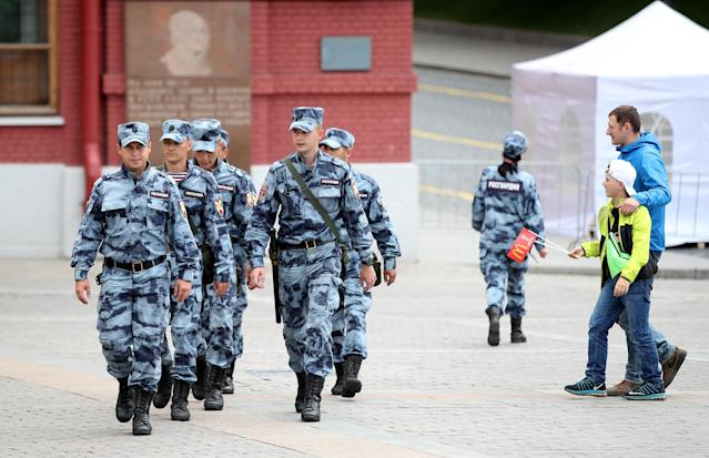Security personel patrol a square in Moscow hours before the start of the tournament. (PA)