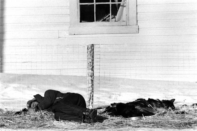 FILE - Bruce Johnson of Atlin, B.C., Canada, takes a nap in the heat of the day at Nikolai checkpoint along the Iditarod trail in Alaska, March 12, 1987. (AP Photo/Rob Stapleton, File)