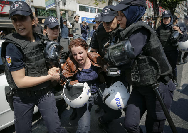 <p>Female police officers detain a woman taking part in May Day protests in Istanbul, Turkey, May 1, 2018. Police detained several demonstrators as the crowd tried to march toward Istanbul's Taksim Square, which is symbolic as the center of protests in which dozens of people were killed in 1977.(Photo: Lefteris Pitarakis/AP) </p>