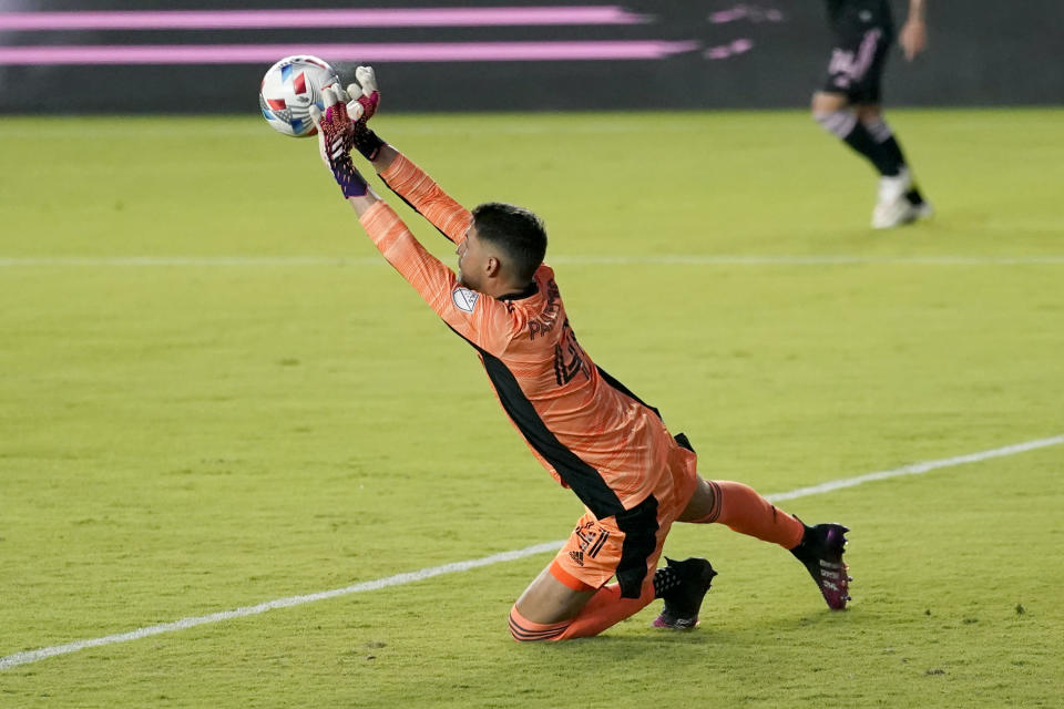 Montreal goalkeeper James Pantemis stops a shot during the first half of the team's MLS soccer match against Inter Miami, Wednesday, May 12, 2021, in Fort Lauderdale, Fla. (AP Photo/Lynne Sladky)