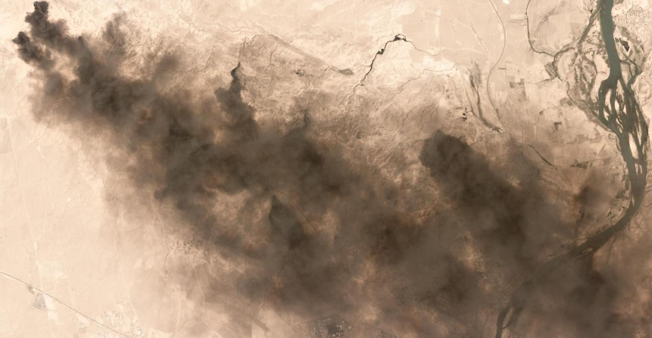 In this image provided by AllSource Analysis, taken Sept. 4, 2016, burning oil fields are seen near Qayyarah, Iraq. A fire at one of Iraq's major oil fields could hinder military and humanitarian efforts as operations to recapture the Islamic State stronghold of Mosul get under way. Black smoke continues to billow into the air from the Qayara oil field, damaged by IS militants last month as they fled the town. There are slow-going Iraqi efforts to contain the fires, but smoke and toxic fumes continue to pollute the air in the area. (AllSource Analysis via AP)