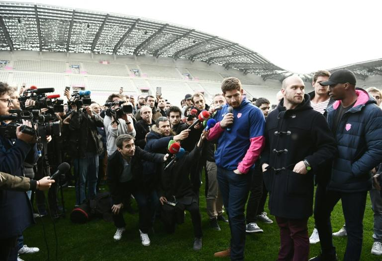 Stade Francais' lock Pascal Pape speaks to journalists at the Stade Jean Bouin in Paris on March 13, 2017, during a demonstration of supporters and players after French rugby giants Racing 92 and Stade Francais announced a shock merger
