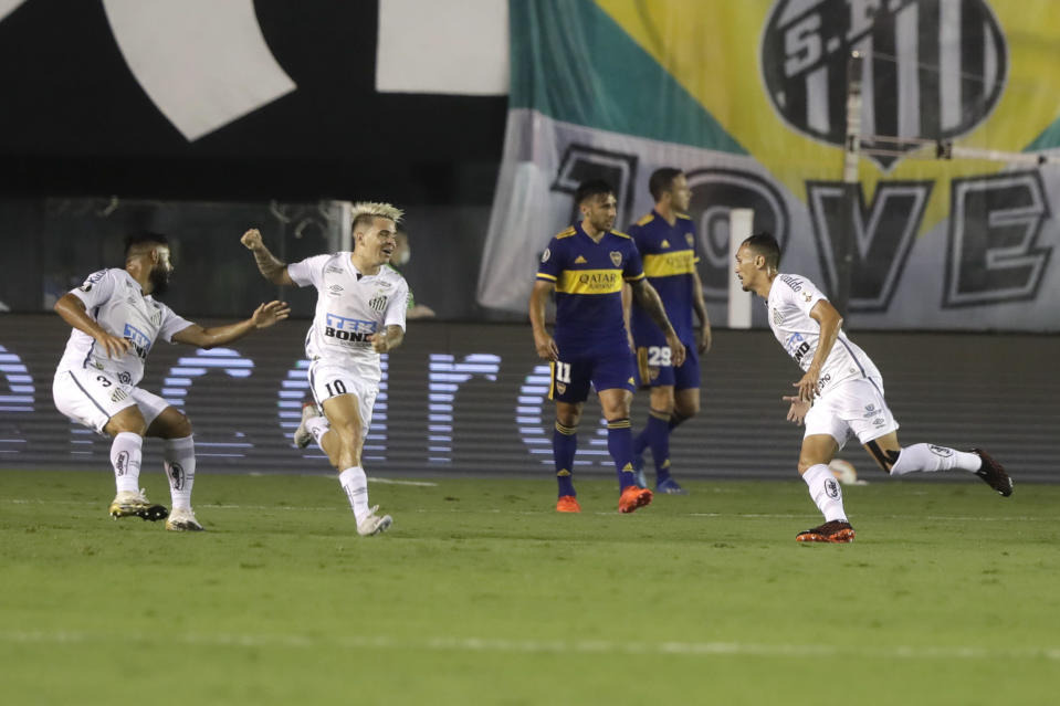 Diego Cristiano of Brazil's Santos, right, celebrates scoring his side's first goal during to a Copa Libertadores semifinal second leg soccer match against Argentina's Boca Juniors in Santos, Brazil, Wednesday, Jan. 13, 2021. (AP Photo/Andre Penner, Pool)