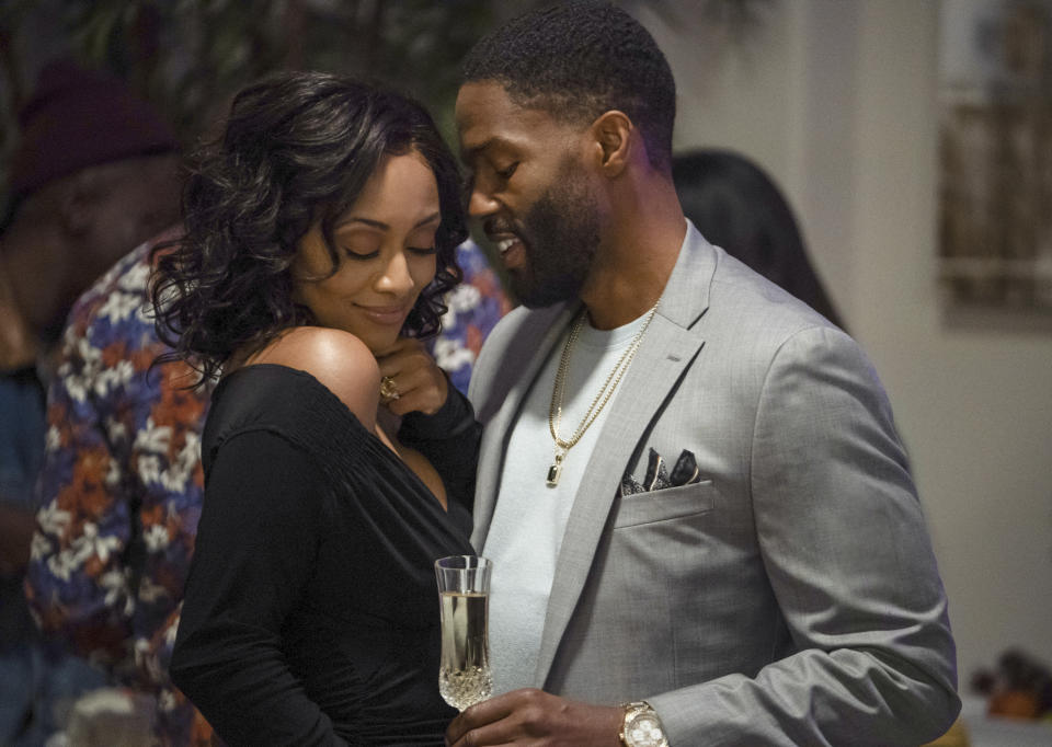 "This image released by Lifetime shows Keri Hilson, left, and Tobias Truvillion in a scene from ""Lust: A Seven Deadly Sins Story,"" premiering Saturday, April 10. (Lifetime via AP)"