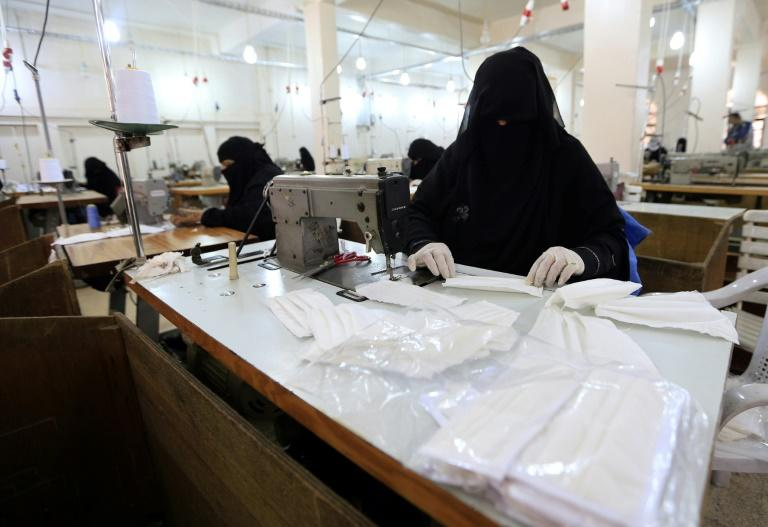 Yemeni women turn out protective masks at a textile factory in the rebel-held capital Sanaa