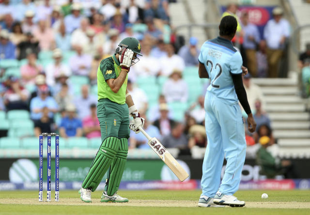 South Africa's Hashim Amla reacts after being struck in the head by a delivery from England's Jofra Archer after taking the wicket of South Africa's Aiden Markram during their Cricket World Cup match at the Oval in London, Thursday, May 30, 2019. (Nigel French/PA via AP)
