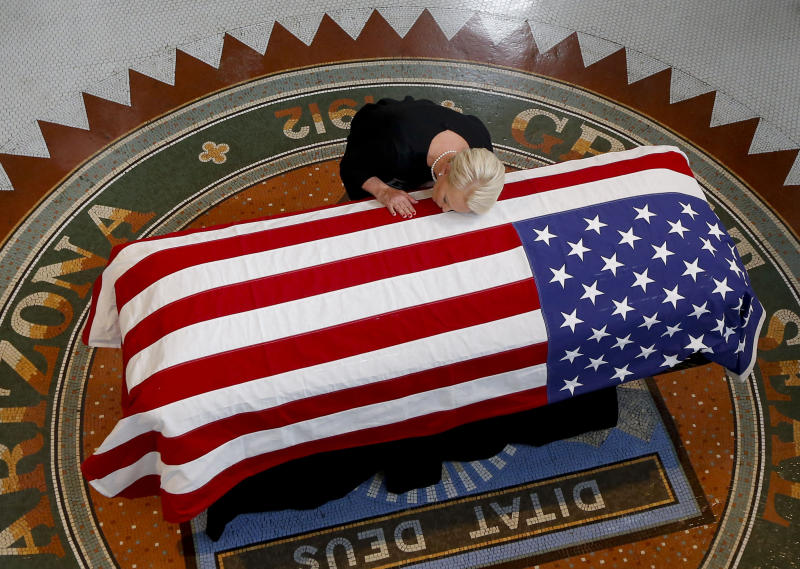 Cindy McCain kisses the casket of her husband, Sen. John McCain, during a memorial service in Phoenix at the state Capitol, Aug. 29. (ROSS D. FRANKLIN / Getty Images)