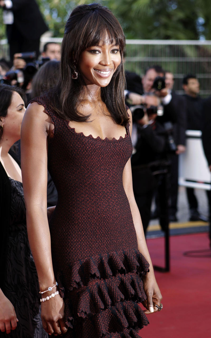 """FILE - In this May 17, 2011 file photo, model Naomi Campbell poses on the red carpet for the screening of """"The Beaver"""" at the 64th international film festival, in Cannes, southern France. Campbell will be honored at the annual The Angel Ball, which supports cancer research on Oct. 17, in New York. (AP Photo/Lionel Cironneau, file)"""