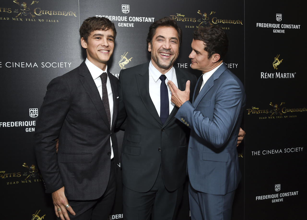 "Actors Brenton Thwaites, from left, Javier Bardem and Orlando Bloom attend a special screening of Walt Disney Studios' ""Pirates of the Caribbean: Dead Men Tell No Tales,"" hosted by The Cinema Society, at the Crosby Street Hotel on Tuesday, May 23, 2017, in New York. (Photo by Evan Agostini/Invision/AP)"