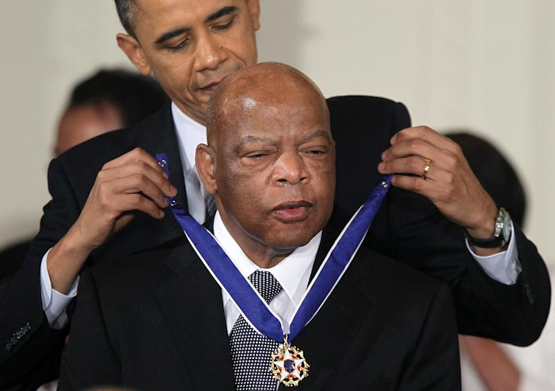 Rep. John Lewis (D-GA) is presented with the 2010 Medal of Freedom by President Barack Obama during an East Room event at the White House February 15, 2011 in Washington, DC. Obama presented the medal, the highest honor awarded to civilians, to twelve pioneers in sports, labor, politics and arts.