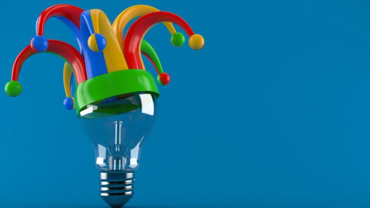 Lightbulb with jester hat perched on top
