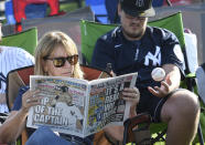 Tammy Roorda, left, of Herkimer, N.Y., and Ryan Derby of Albany, N.Y., wait for the start of the National Baseball Hall of Fame induction ceremony at the Clark Sports Center, Wednesday, Sept. 8, 2021, in Cooperstown, N.Y. (AP Photo/Hans Pennink)