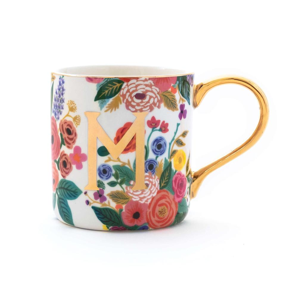 "No one in the family will ever mistake her mug for theirs again. Pair this pretty monogrammed mug with a bag of a <a href=""https://www.glamour.com/story/jot-coffee-review?mbid=synd_yahoo_rss"" rel=""nofollow noopener"" target=""_blank"" data-ylk=""slk:her favorite coffee"" class=""link rapid-noclick-resp"">her favorite coffee</a> or tea for an extra-thoughtful gift. Rifle Paper offers free domestic shipping on orders over $50, or pay $14 for two-day delivery if you're down to the wire. $14, Rifle Paper Co.. <a href=""https://riflepaperco.com/garden-party-monogram-mug"" rel=""nofollow noopener"" target=""_blank"" data-ylk=""slk:Get it now!"" class=""link rapid-noclick-resp"">Get it now!</a>"