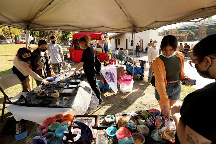 Alejandra Leal, second from left, has oddities for sale in Echo Park.