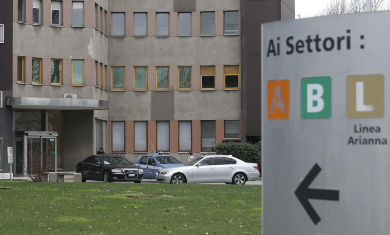 The car of former Italian premier Silvio Berlusconi is parked at the San Raffaele hospital, in Milan, Italy, Saturday, March 9, 2013. Former Italian Premier Silvio Berlusconi was being treated in a Milan hospital for eye inflammation that prevented him from attending his sex-for-hire trial. (AP Photo/Luca Bruno)