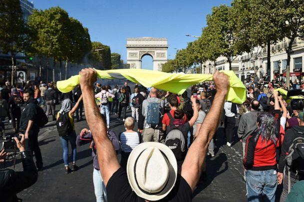 PHOTO: A man holds up a yellow vest in front of the Arc de Triomphe on the Champs Elysees avenue during an anti-government demonstration called by the 'yellow vest' (gilets jaunes) movement, on September 21, 2019 in Paris. (Lucas Barioulet/AFP/Getty Images)