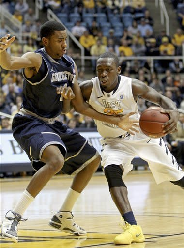 Georgetown's Hollis Thompson, left, guards West Virginia's Darryl Bryant (25) during the second half of an NCAA college basketball game in Morgantown, W.Va., on Saturday, Jan. 7, 2012. West Virginia won 74-62. (AP Photo/David Smith)